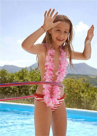 Young blonde girl with hula hoop and pink garland around neck by swimming pool Stock Photo - Rights-Managed, Code: 822-02124379
