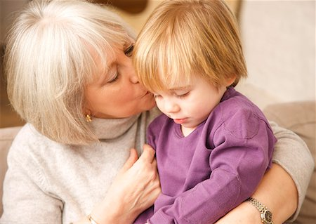 people kissing little boys - Close up of grey haired grandmother kissing grandchild Stock Photo - Rights-Managed, Code: 822-02124590