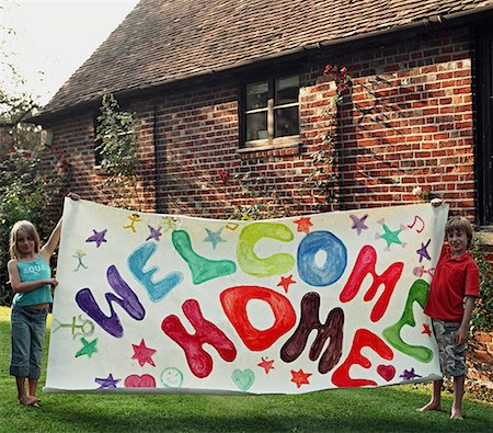 Portrait of two young childrend holding colourful welcome home sign Stock Photo - Rights-Managed, Code: 822-02124615