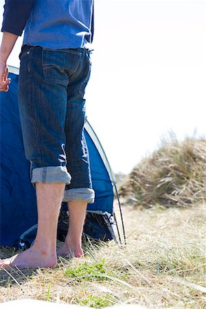 Portrait of young man legs standing by tent Stock Photo - Rights-Managed, Code: 822-02136704