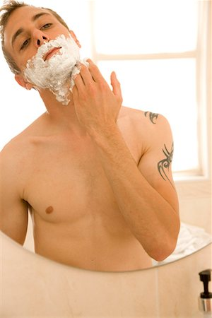 personal care - Portrait of young man applying shaving cream and mirror reflection Stock Photo - Rights-Managed, Code: 822-02136877