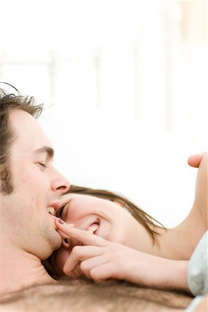 doing sex - Close up of couple in bed laughing Stock Photo - Rights-Managed, Code: 822-02137338