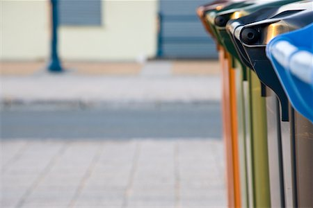 Close up of recycling bins on a paved street Stock Photo - Rights-Managed, Code: 822-02315305