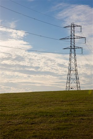 Electricity pylon on a field Stock Photo - Rights-Managed, Code: 822-02315421