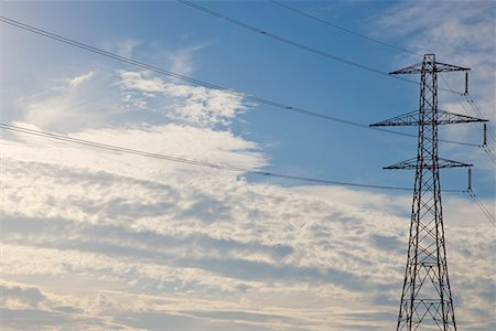 Electricity pylon with blue sky Stock Photo - Rights-Managed, Code: 822-02315422