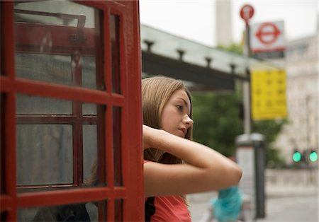 Teenaged girl exiting a London phone booth Stock Photo - Rights-Managed, Code: 822-02620706