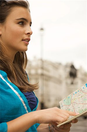 Teenaged girl holding a city map Stock Photo - Rights-Managed, Code: 822-02620731