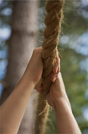 Close up of a woman hands hanging from a rope Stock Photo - Rights-Managed, Code: 822-02620768