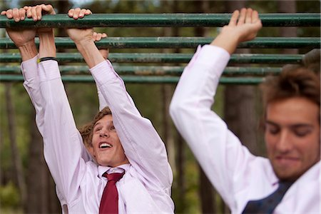Businessmen at an obstacle course dangling from parallel bars Stock Photo - Rights-Managed, Code: 822-02620775