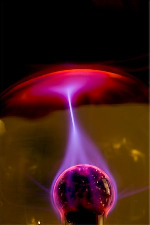 plasma - Plasma ball with red purple and pink electrical discharge Stock Photo - Rights-Managed, Code: 822-02621413