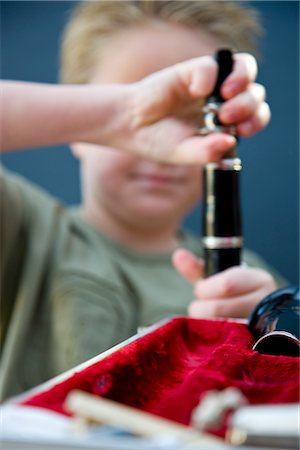 Close up of a boy hands putting together a clarinet Stock Photo - Rights-Managed, Code: 822-02621489