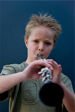 Boy playing the clarinet Stock Photo - Rights-Managed, Code: 822-02621496