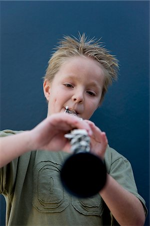Boy playing the clarinet Stock Photo - Rights-Managed, Code: 822-02621497