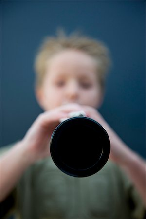 Boy playing the clarinet Stock Photo - Rights-Managed, Code: 822-02621499