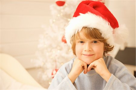 Close up of a boy wearing a red and white Christmas hat Stock Photo - Rights-Managed, Code: 822-02739120