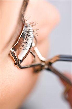 Profile of woman using an eyelash curler - extreme close up Stock Photo - Rights-Managed, Code: 822-02739335