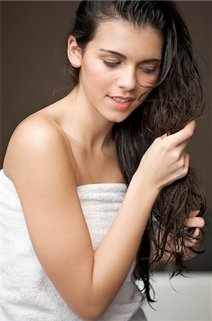 personal care - Close up of a woman touching her long wet hair Stock Photo - Rights-Managed, Code: 822-02739346
