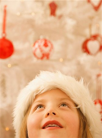 Close up of a girl in a furry Christmas hat looking up Stock Photo - Rights-Managed, Code: 822-02739355