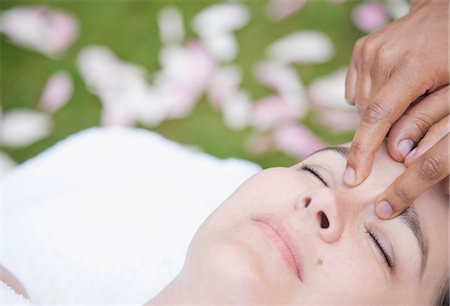 facial - Close up of a woman receiving a  facial massage outdoor Stock Photo - Rights-Managed, Code: 822-02958209