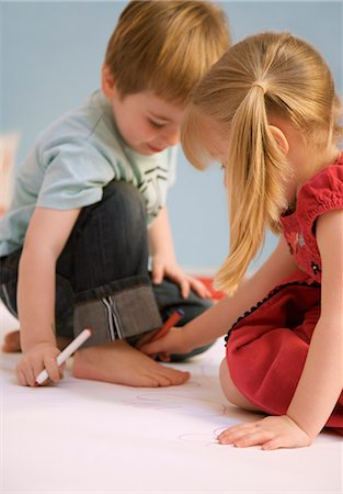 Girl drawing the outline of a boy foot Stock Photo - Rights-Managed, Code: 822-02958415