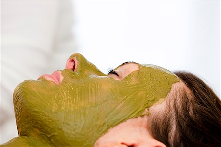 facial - Profile of a woman with green facial mask Stock Photo - Rights-Managed, Code: 822-02958448