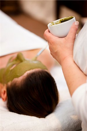 facial - Beautician hand applying green facial mask on woman face Stock Photo - Rights-Managed, Code: 822-02958508