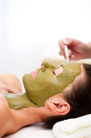 facial - Beautician hand applying green facial mask on woman face Stock Photo - Rights-Managed, Code: 822-02958535