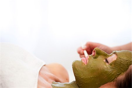 facial - Beautician hand applying green facial mask on woman face Stock Photo - Rights-Managed, Code: 822-02958553