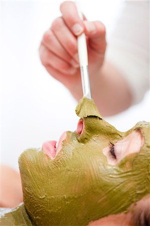 facial - Beautician hand applying green facial mask on woman face with brush Stock Photo - Rights-Managed, Code: 822-02958577