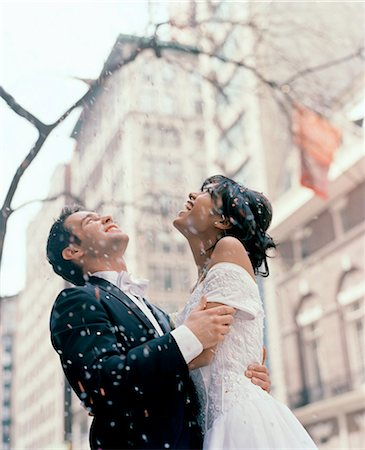 Bride and groom standing under a confetti shower in a New York street Stock Photo - Rights-Managed, Code: 822-02958581