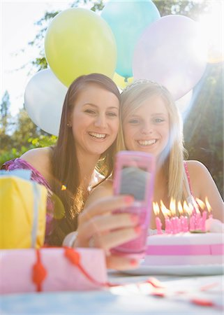 Teenaged girls at birthday party taking a self portrait  with mobile phone Stock Photo - Rights-Managed, Code: 822-03161724