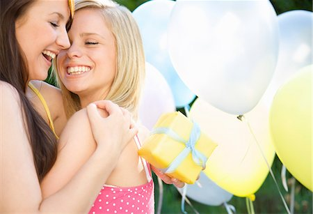 Close up of two smiling teenaged girls at birthday party Stock Photo - Rights-Managed, Code: 822-03161739