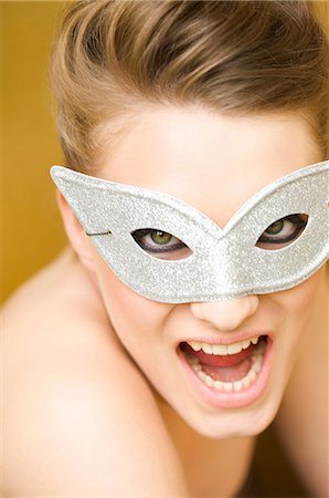 Close up of a young woman wearing a party mask Stock Photo - Rights-Managed, Code: 822-03161763