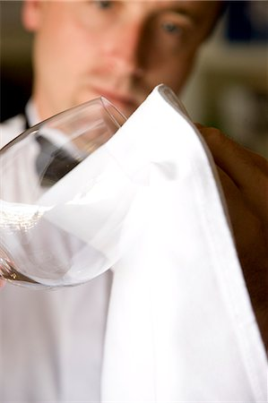 Close up of a waiter polishing a wine glass Stock Photo - Rights-Managed, Code: 822-03161814