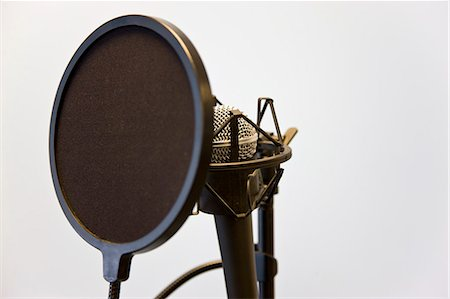 Close up of a microphone and pop filter Stock Photo - Rights-Managed, Code: 822-03161821