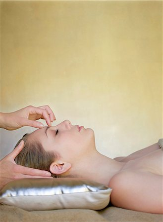 facial - Close up profile of a young woman receiving a head massage Stock Photo - Rights-Managed, Code: 822-03161852