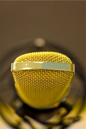 Extreme close up of a gold microphone Stock Photo - Rights-Managed, Code: 822-03161923