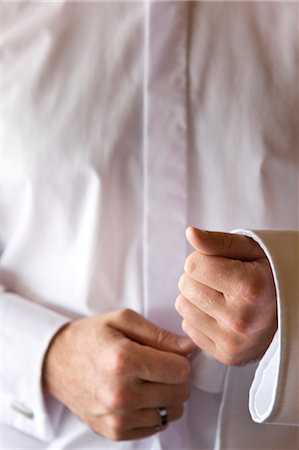 Close up of a waiter's hands with napkin resting on his forearm Stock Photo - Rights-Managed, Code: 822-03161989