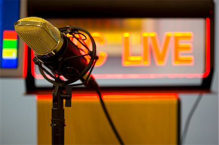 Close up of a gold microphone and illuminated sign Stock Photo - Rights-Managed, Code: 822-03162043
