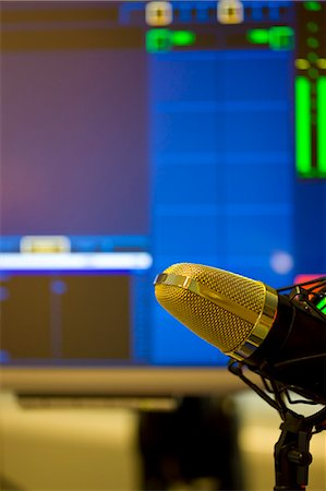 Close up of a gold microphone on a pedestal Stock Photo - Rights-Managed, Code: 822-03162088
