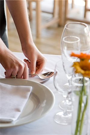 placing - Close up of a waitress's hands arranging cutlery on a restaurant table Stock Photo - Rights-Managed, Code: 822-03162100
