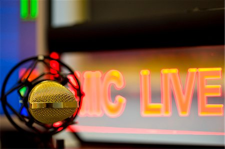 Close up of a gold microphone and illuminated sign Stock Photo - Rights-Managed, Code: 822-03162115