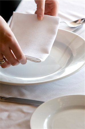 placing - Close up of a waitress's hands arranging a napkin on a restaurant table Stock Photo - Rights-Managed, Code: 822-03162137