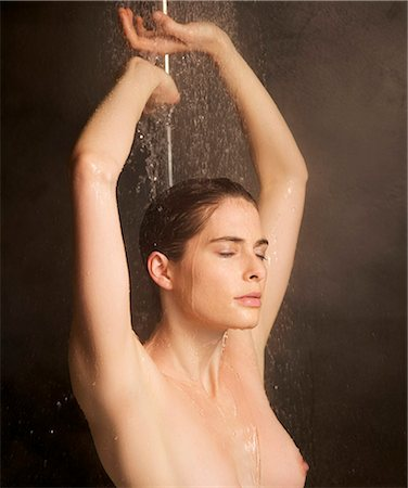 Close up of a woman showering with arms over head Stock Photo - Rights-Managed, Code: 822-03406659