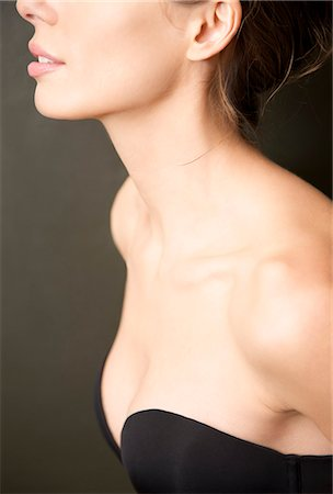 Close up profile of a young woman wearing a strapless black bra Stock Photo - Rights-Managed, Code: 822-03406672
