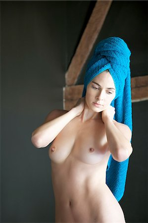Portrait of a nude woman with towel wrapped over head Stock Photo - Rights-Managed, Code: 822-03406827