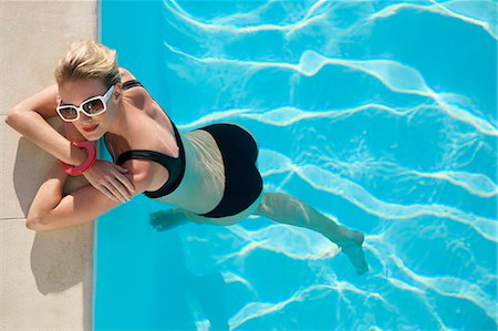 Elevated view of a woman at edge of swimming pool Stock Photo - Rights-Managed, Code: 822-03406876