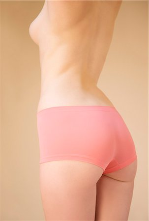 Back view of a woman's body wearing pink underwear - headless Stock Photo - Rights-Managed, Code: 822-03406897