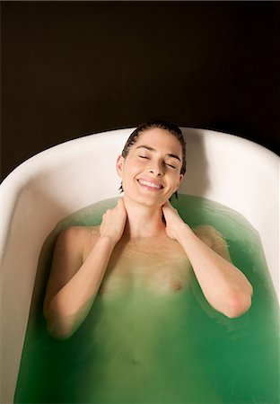 Portrait of a nude woman taking a bath Stock Photo - Rights-Managed, Code: 822-03406929