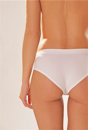 Back view of a woman's body wearing white underwear - headless Stock Photo - Rights-Managed, Code: 822-03406961